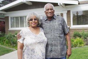an elderly couple consider their senior living options